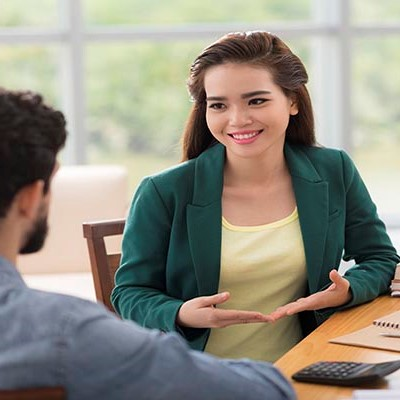A human ecology professional speaks with a client.