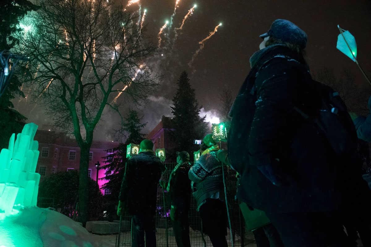Green & Gold Winterfest lit up Quad with light installations, pyrotechnics and fireworks off the roof of Athabasca Hall