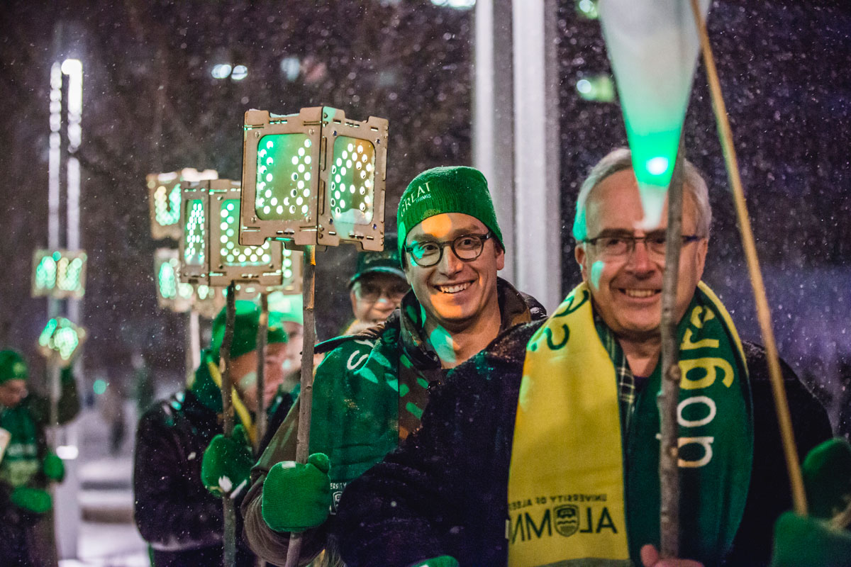 Alumni Association president Glenn Stowkowy, '76 BSc(ElecEng), leads the 110 lantern bearers followed by Daily Planet host and Winterfest guest speaker Dan Riskin, '97 BSc.