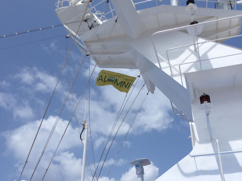 Alumni Association Flag flying over the Indian Ocean on the Regatta