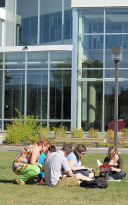 A photo of professor Kim Misfeldt teaching a class outside in the Quad