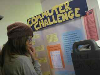 A student looking at the Commuter Challenge display