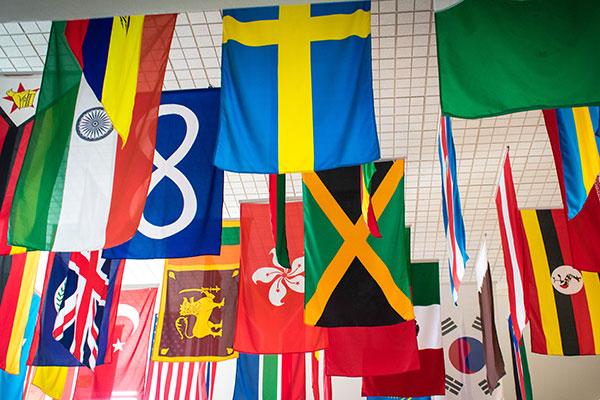 A photo of flags from various countries hanging in the Faith and Life Lounge