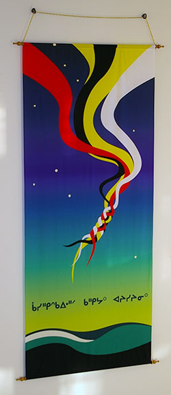 A photo of a banner designed in 2011 by Aboriginal students to help welcome and signify the presence of Aboriginal students on campus.