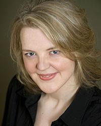 A portrait photo of Jana O