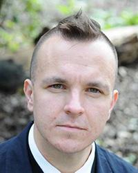 A portrait photo of Matthew Gusul