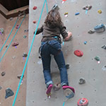 Photo of a girl on the climbing wall