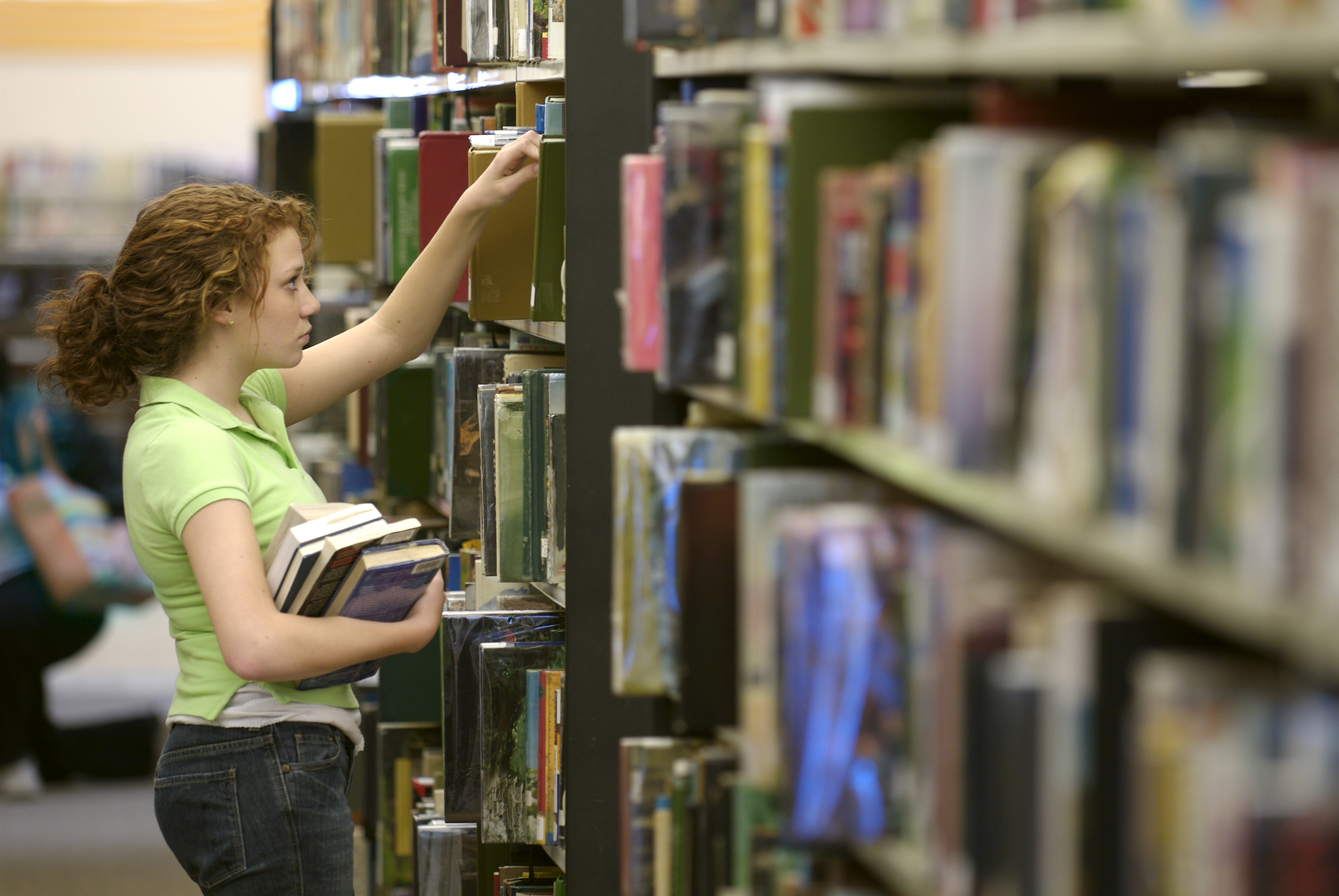A student gathers books in the Augustana Library