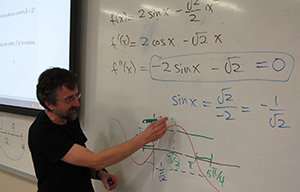 Professor Bill Hackborn instructing at a whiteboard