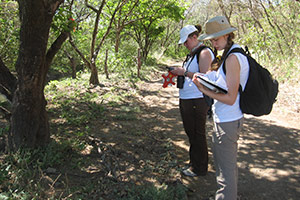 A photo of 2 students taking field notes in Costa Rica