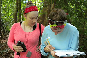 A photo of two students writing field notes in Costa Rica