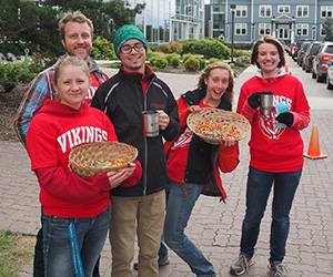 Student chaplains greeting First Year students on move in day
