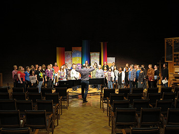 A photo of a choir director leading a choir