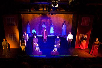 An image of a play with stage lighting