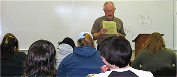 A photo of Professor Rani Palo teaching a class
