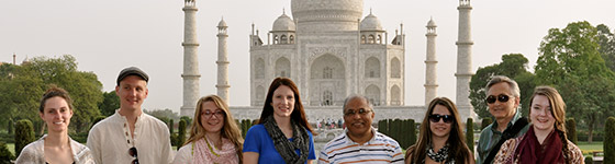 A photo of students and instructors in front of the Taj Mahal