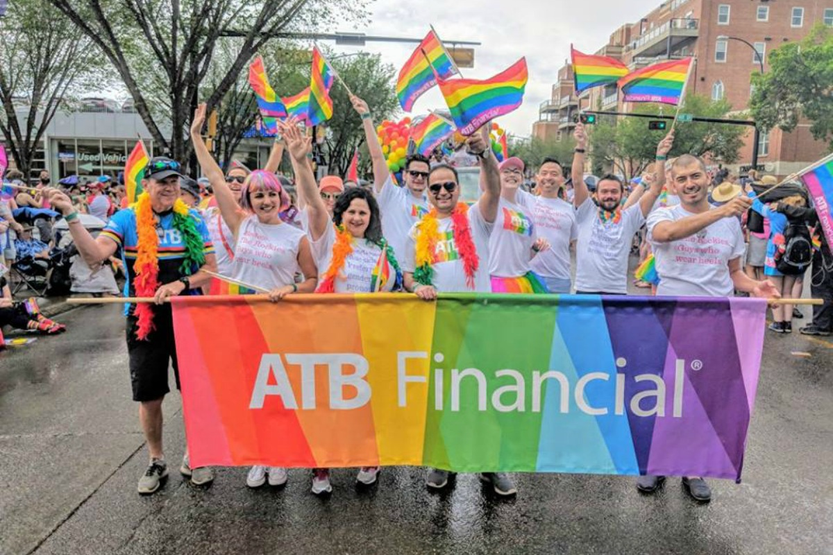 ATB flag in front of celebrating parade goers at Pride
