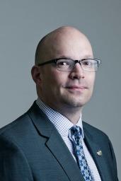 Dr Kris Wells