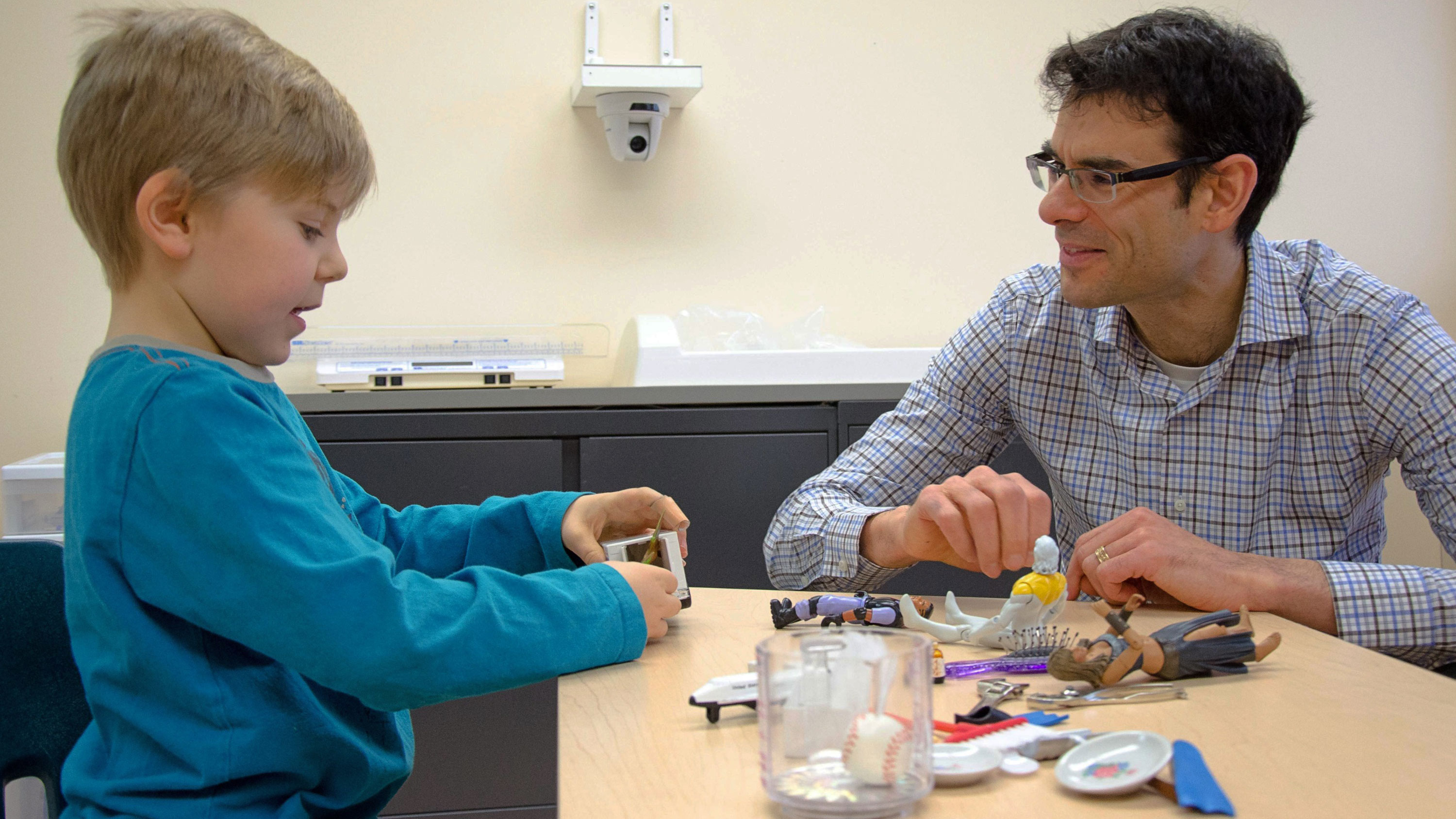Lonnie Zwaigenbaum conducting a study with a young patient