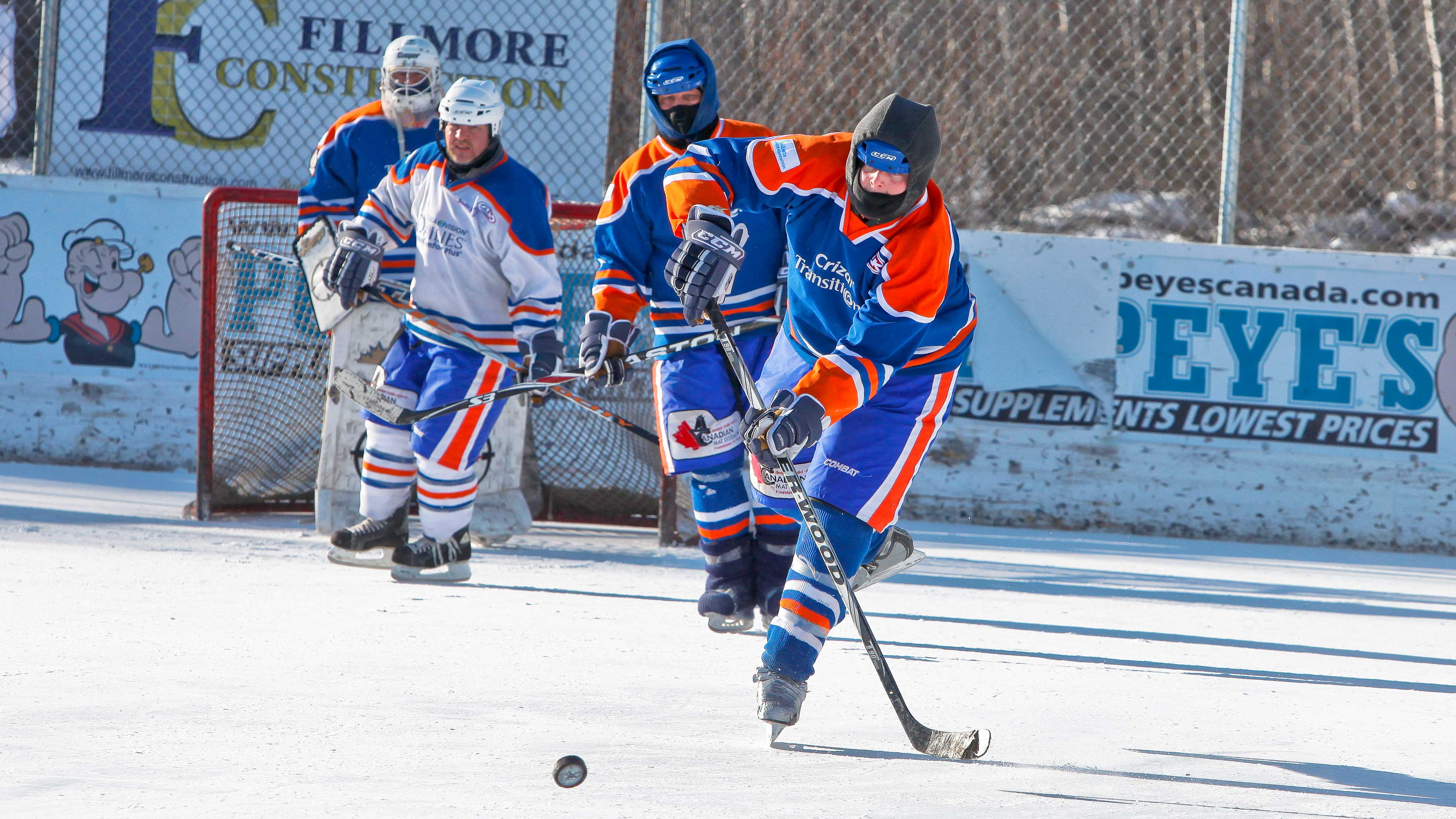 Three hockey players in the worlds longest hockey game