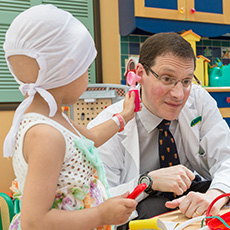 Dr. David Eisenstat with patient – Cancer Research Institute of Northern Alberta