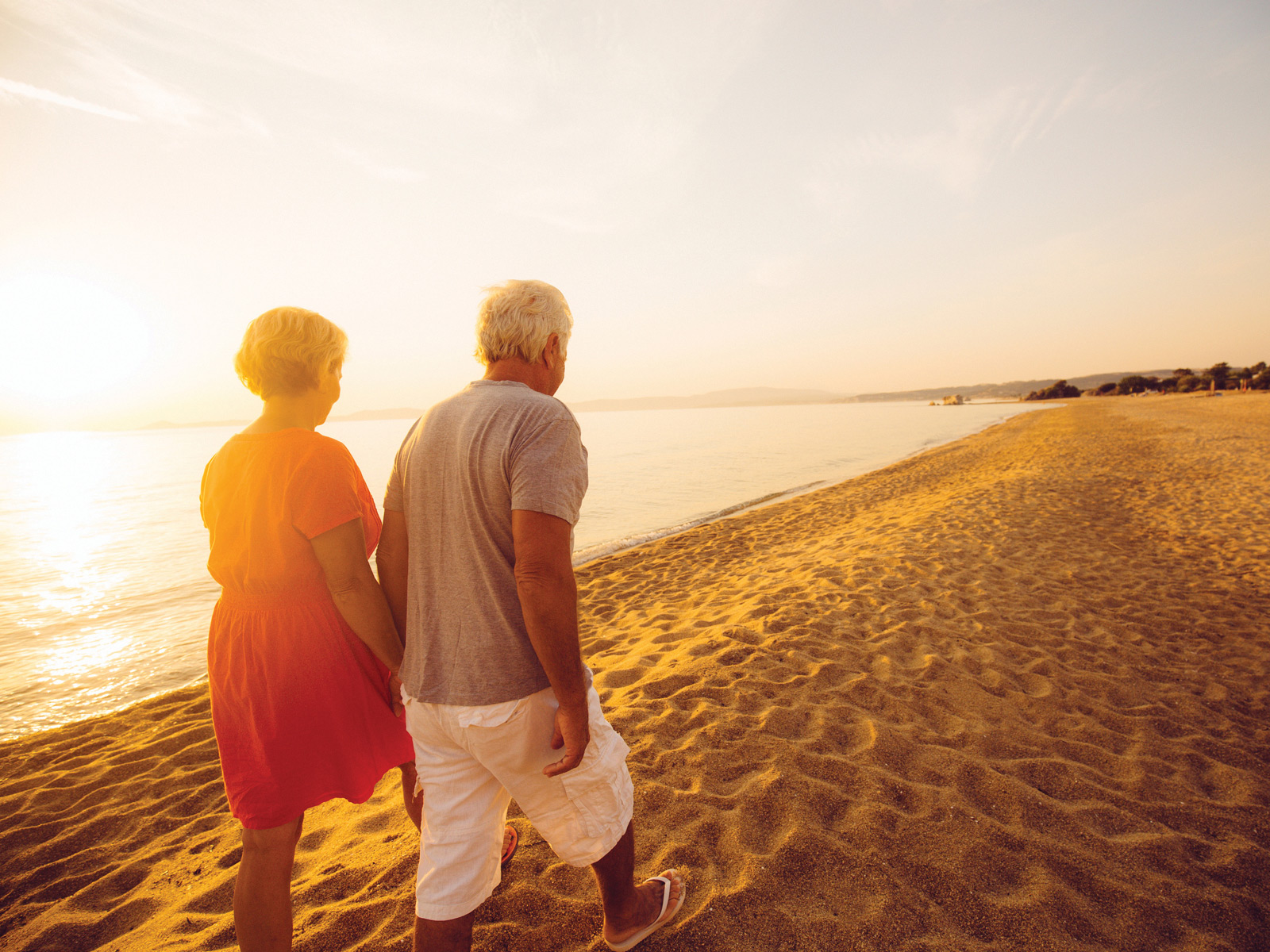 Retired couple on beach (credit: iStock)
