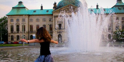 PLLC Student dances in front of a waterfall in Dresden