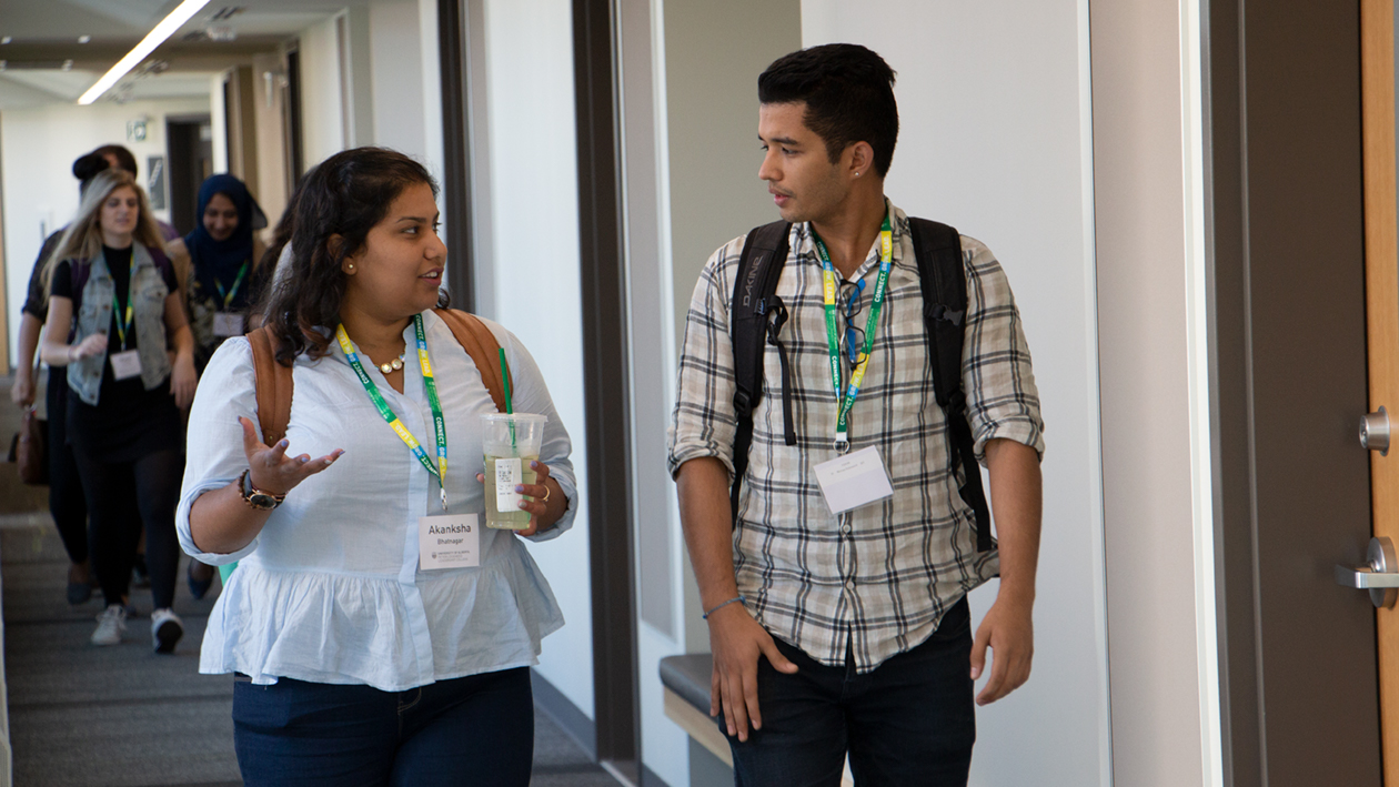 Akanksha talking to a fellow scholar