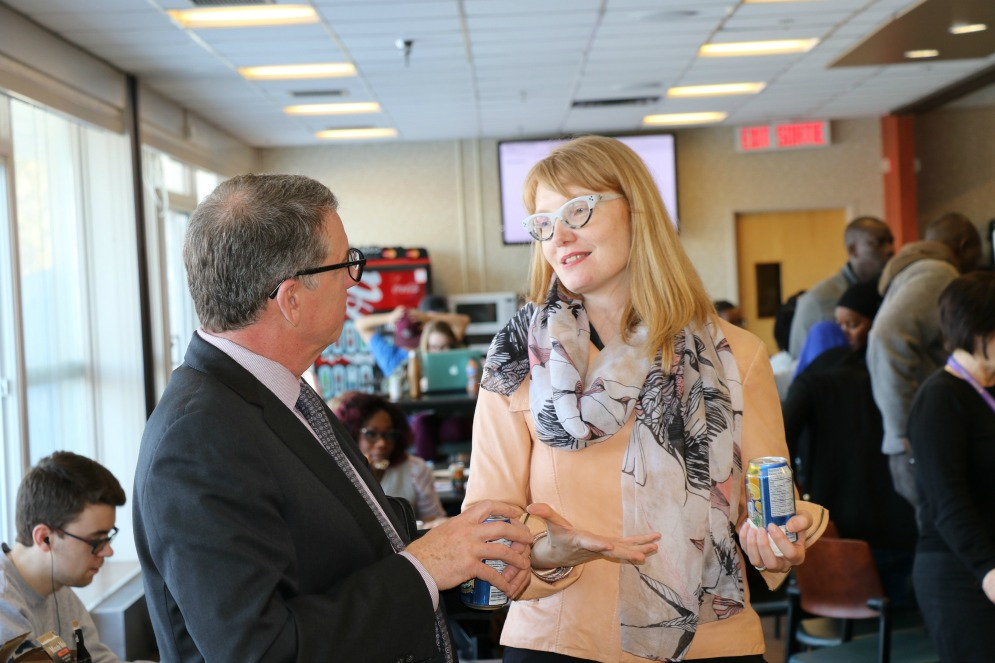 President Turpin speaks with Sheena Wilson, an Associate Professor at U of A's Campus Saint-Jean.
