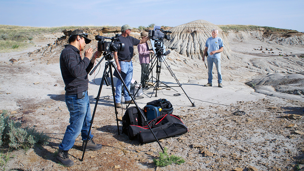 The film crew prepares for a taping of Dr. Phil Currie in Dinosaur Provincial Park for Dino101.