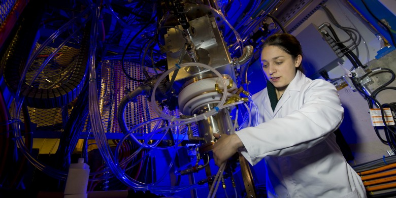 Katie Gagnon, a member of Sandy McEwan's research team, works on the new cyclotron in UAlberta's refitted Balmoral Centre.
