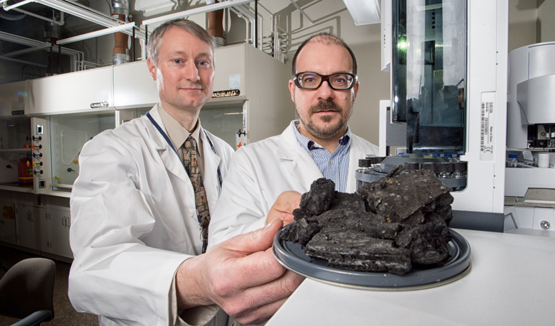 UAlberta researcher James Harynuk (right) and RCMP scientist Mark Sandercock are teaming up to develop a computer program that can sift through chemical clues to determine what caused deliberately set fires.