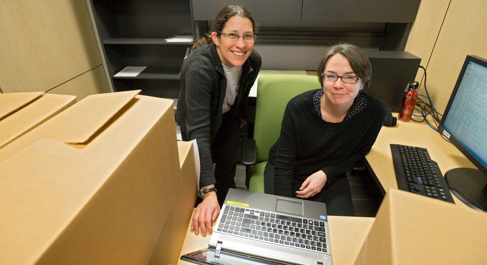 Post-doctoral fellow Kendall Roark (right) and metadata librarian Sharon Farnel with some of the 390 electronic files and 135 cubic feet of paper data from maternal, infant and child research.