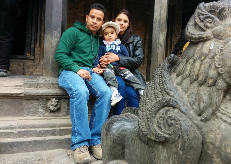 Baiku Acharya with his family at a historic monument in Patan Durbar Square in Kathmandu Valley in February 2015. The site was destroyed in the earthquake that struck Nepal April 25.