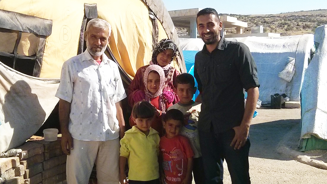 Alumnus Saleem Al-Nuaimi with a family during a trip to Syria