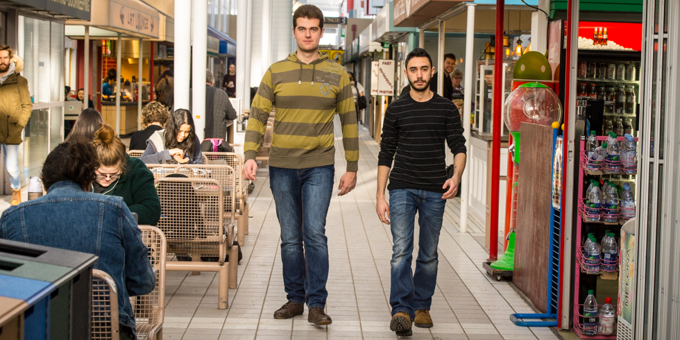 Syrian students Naseem Alrayes (left) and Badi Jabbour take a stroll though HUB Mall