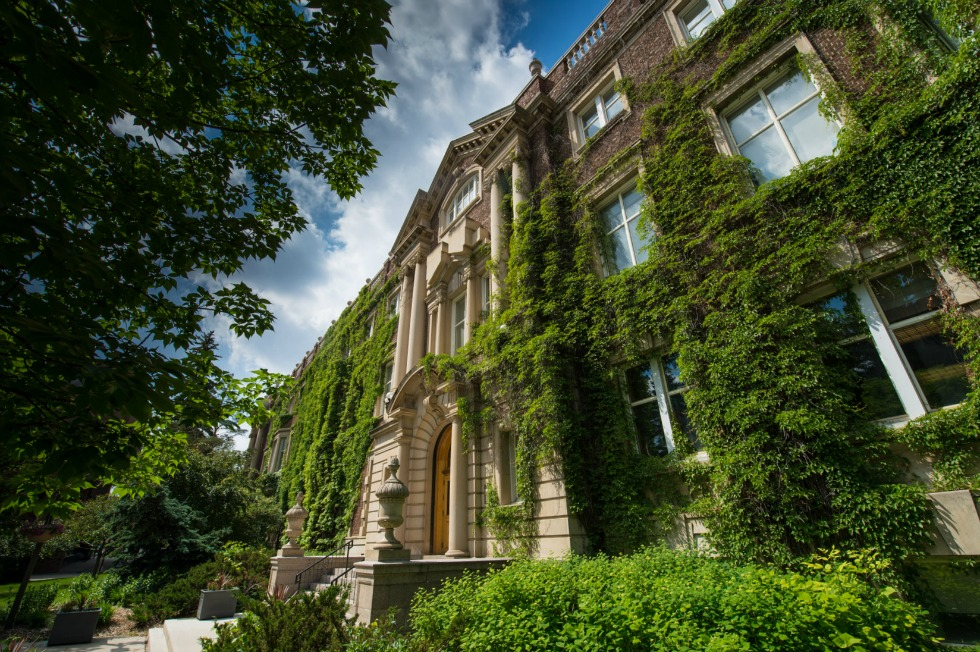 The Arts Building, festooned with lush greenery, is a signature sight on the UAlberta campus.