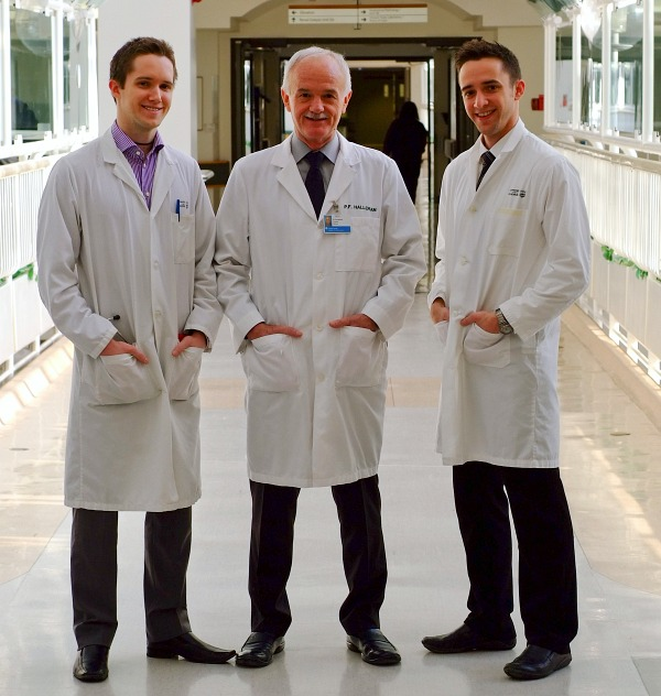 Philip Halloran is flanked by his sons Brendan and Kieran, both of whom are now medical professors at UAlberta.