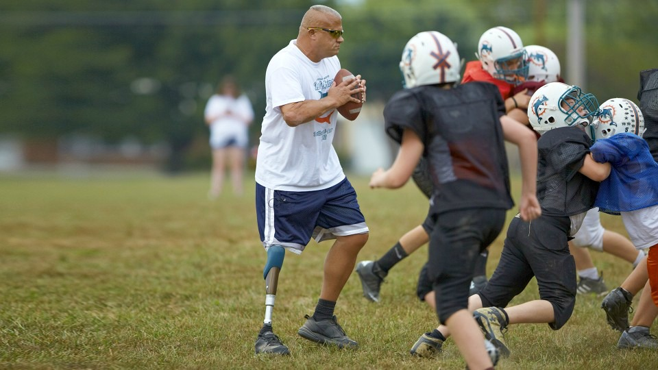 A C-Leg prosthesis wearer plays a game of football. (Photo: Ottobock USA)