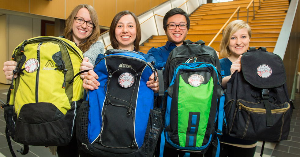 (From left) Kelsey McDougall, Katelyn Lee, Kevin Chung and Elizabeth Morris raised enough donated items to fill 33 backpacks for homeless people being discharged from Edmonton's Royal Alexandra Hospital. (Photo: Richard Siemens)