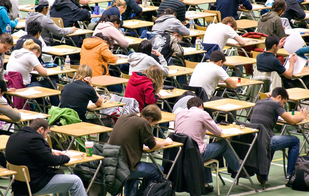 Students write a final exam in the Butterdome at the University of Alberta.