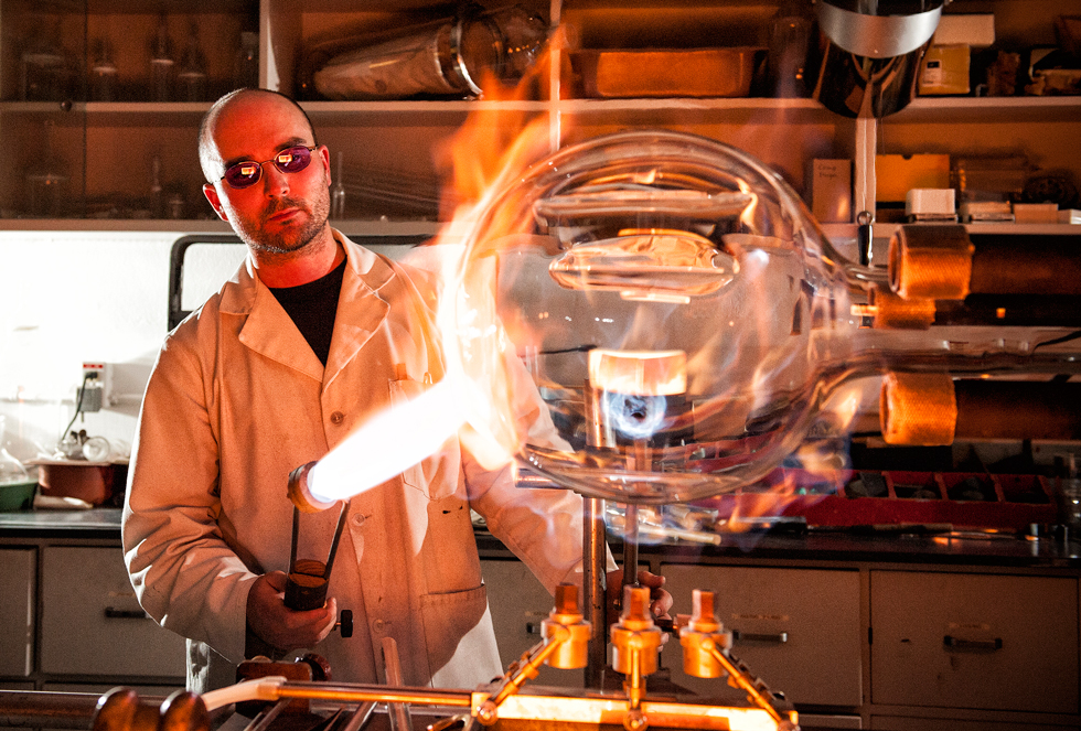 U of A scientific glass-blower Jason Dibbs at work
