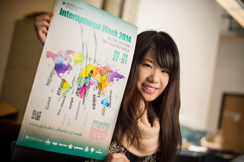 Melody Du with her winning poster design for UAlberta's International Week 2014