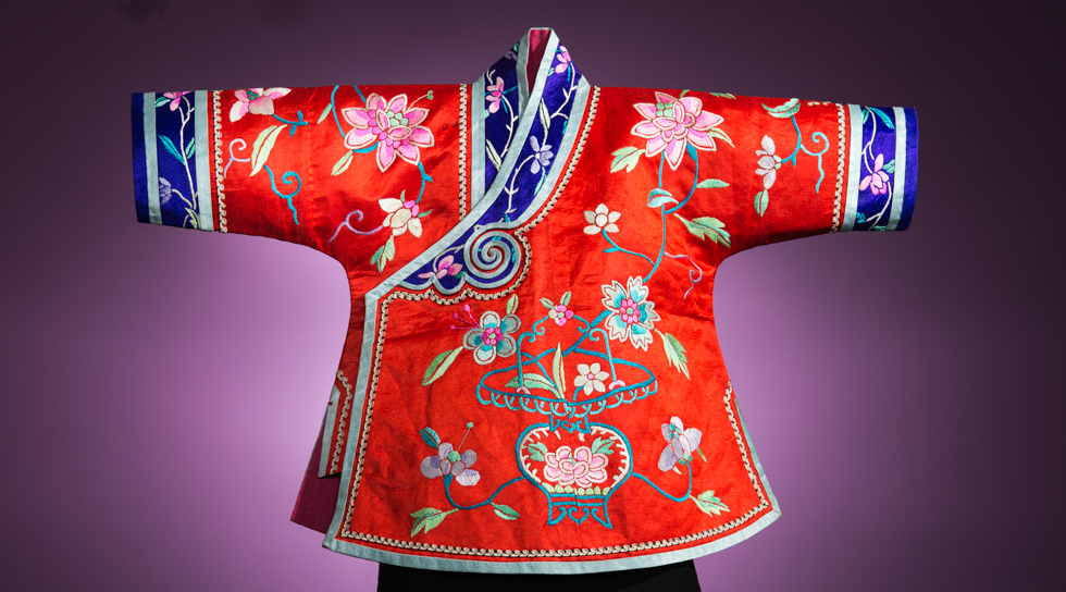 More than just a cheerful robe for a treasured male heir, this little coat from China's Qing Dynasty (1875–1900) was fashioned to ward off evil spirits in late imperial China, when infant mortality was a constant threat.