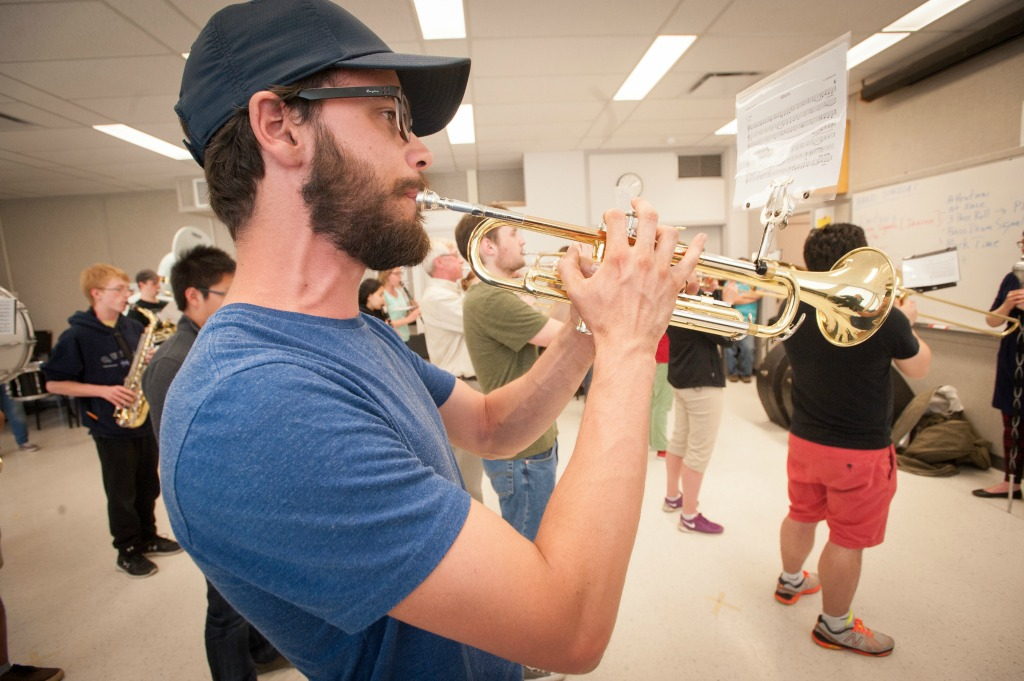 The U of A Marching Band may look like a ragtag group during rehearsal, but wait until you hear them.