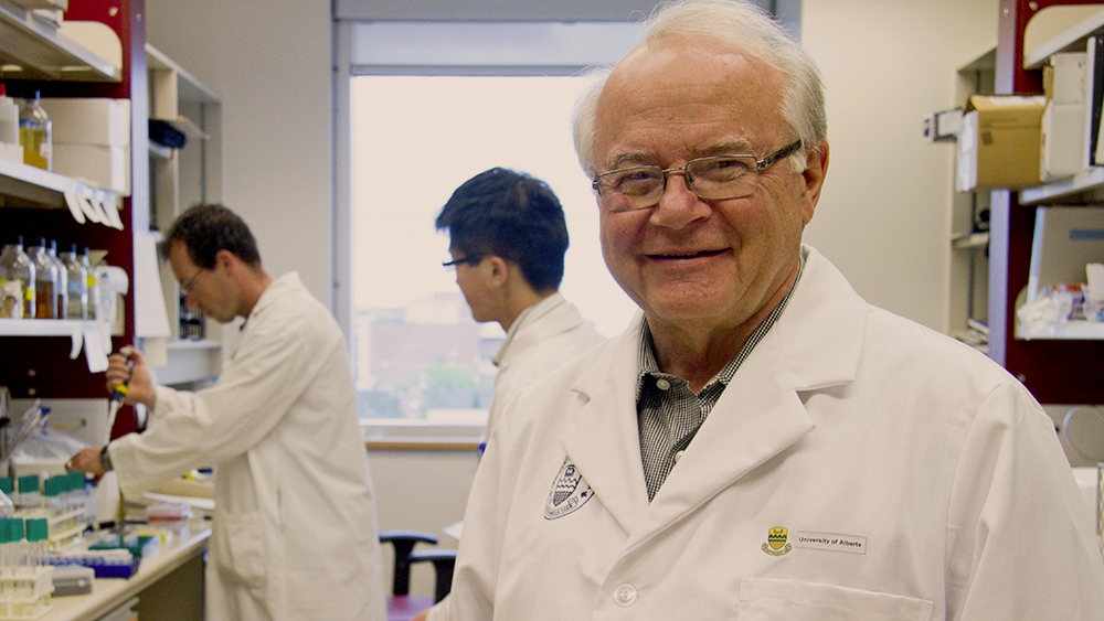 Lorne Tyrrell in the lab with students