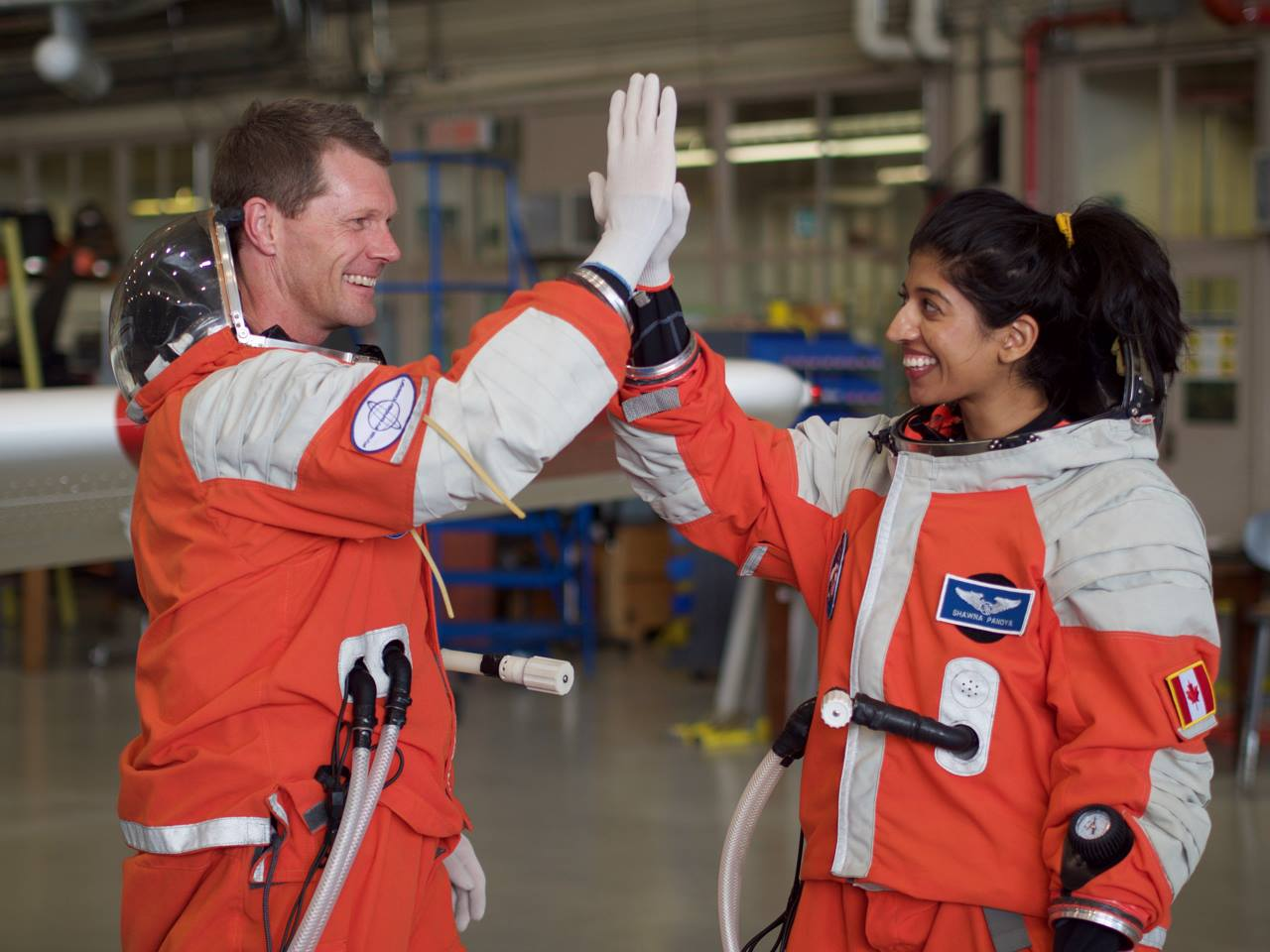 Shawna Pandya (right) gives crewmate Callum Wallach a high-five.