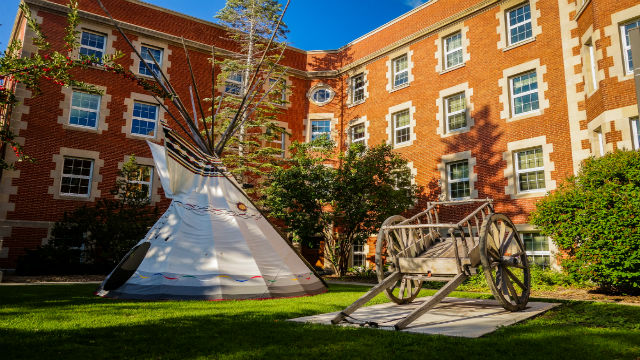 Pembina Hall with Tipi and Red River Cart