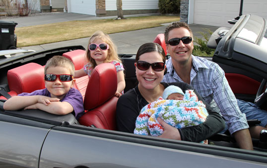 Eric Saude with his family