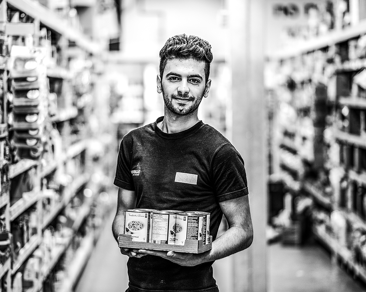 Syrian student working as a stock clerk